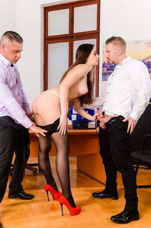 Secretary in stockings is double penetrated by the boss and his business partner