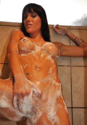 Eager mom ain't washing body only but wanking snatch after the shower likewise