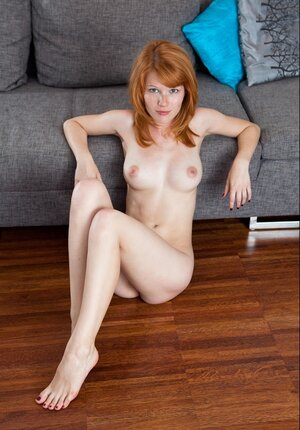 Name of this remarkable redhead with pale skin and furthermore nice breasts is Mia Sollis