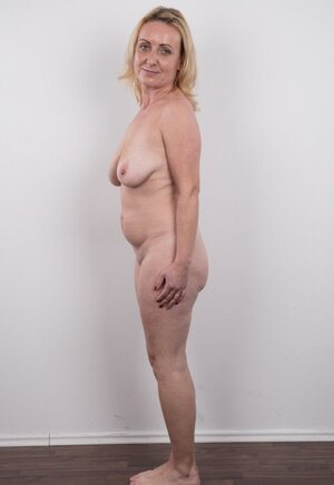 Dirty old woman has saggy tits and plus belly but still poses nude in studio