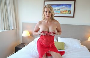 Blonde grown-up with awesome breasts arranges in bedroom petite strip show