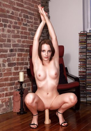 Woman melomaniac likes to listen to music and moreover stuff pink slit with a dildo