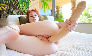 Chick with red hair Zoey Nixon takes thick dildo inside her innocent pussy
