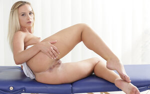 Blonde masseuse performs a super-hot striptease show at her working place