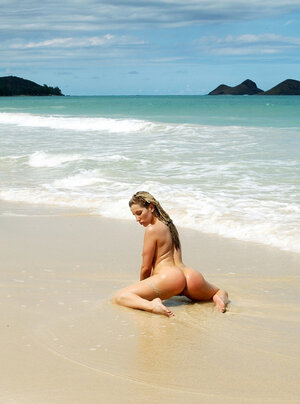 Lady poses on the rocks squirming and besides shaking her tushy on the ocean shore